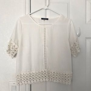 Francesca's white blouse